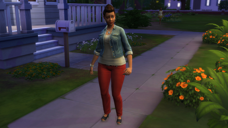 Stacey stands somewhere on the street with a weird expression on her face