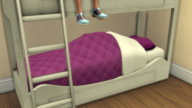 Rachel hides under her doona