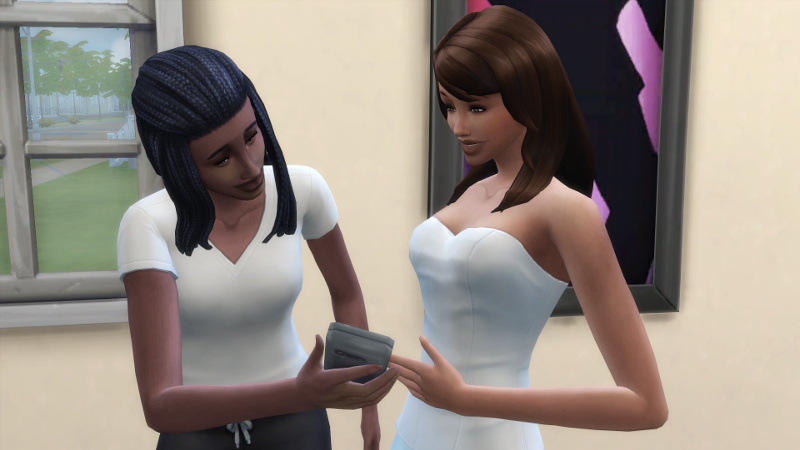 Christina shows her phone to Claire