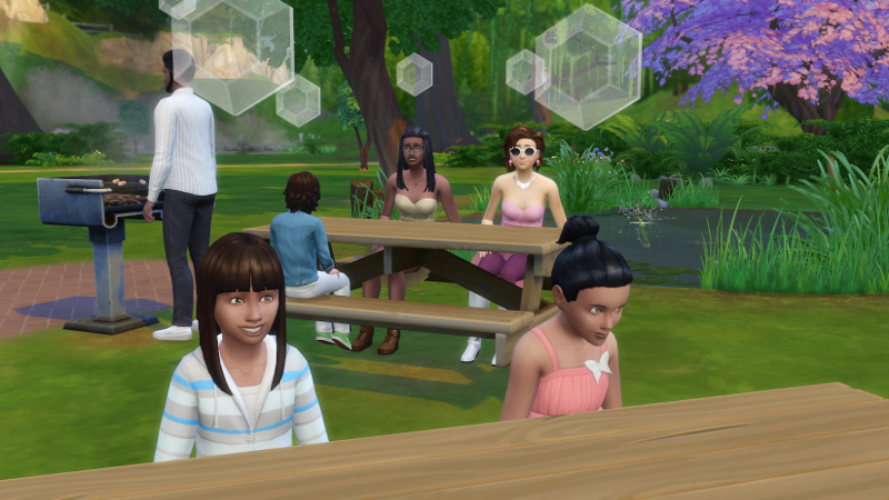 Zoe and Rachel sit together, as Christina, Liberty Lee and Kason Lee sit at the table behind them