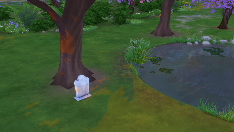 a tombstone is located under a tree