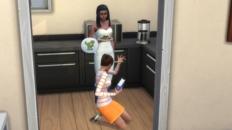 Rachel kneels on the floor of the kitchen with her homework, while telling Christina (who is holding a plate of salmon and smiling awkwardly) about dinosaurs