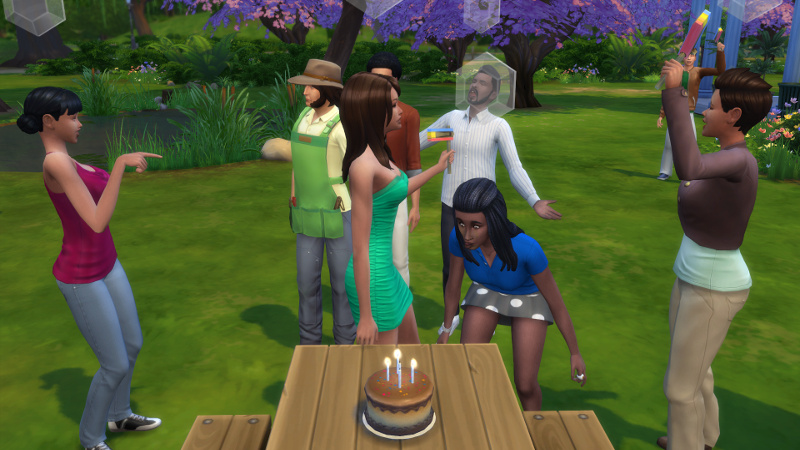 Christina blows out her birthday candles as chaos rages behind her