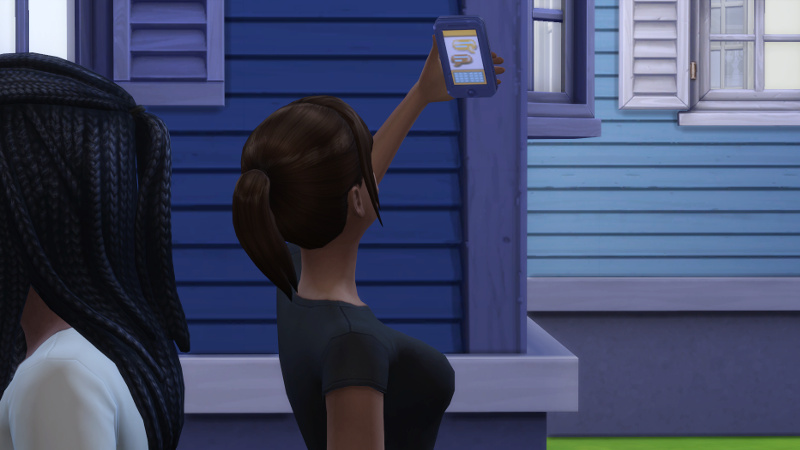 Rachel takes a selfie in front of the new house