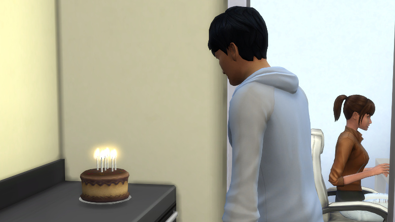Julian stands in front of a birthday cake