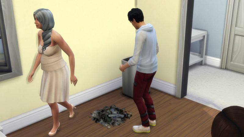 Julian dumps more rubbish on the floor; Tabitha walks away smirking