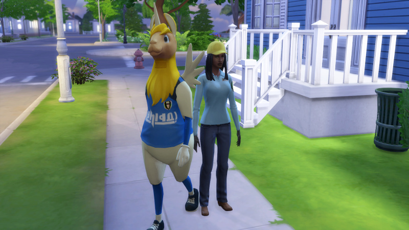 Christina (in hard hat) and Claire (in unicorn costume) stand outside the house