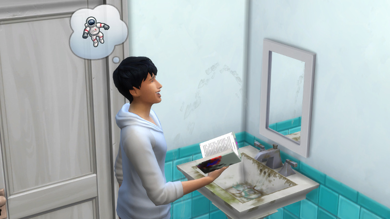 Julian laughs at his science fiction book in front of a dirty sink in a bathroom