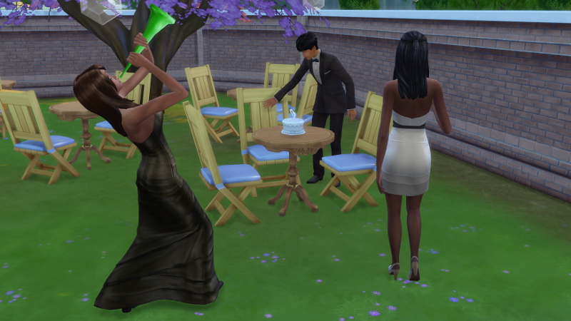Julian moves to cut the cake as Claire blows a horn