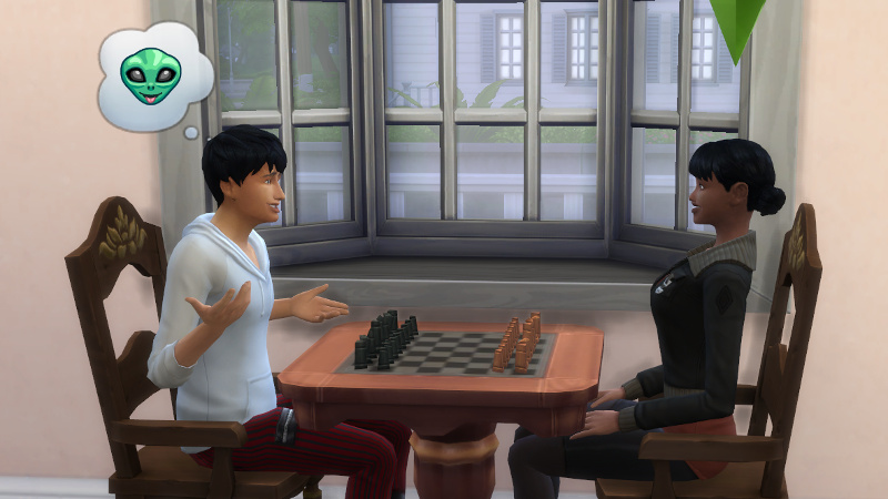 Julian shrugs at Zoe over a chessboard, thinking about aliens