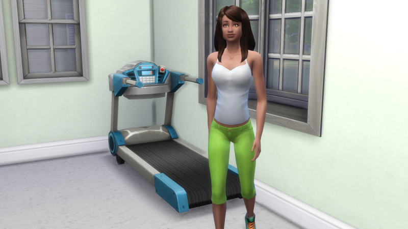Claire walks away from her treadmill, a slight baby bump showing
