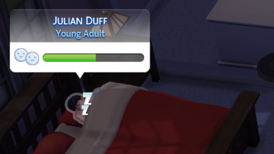 Julian Duff sleeps in a bed with a red doona