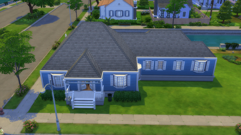 exterior shot of house: there is now an awning over the front porch