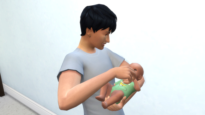 Julian feeds a bottle to Troy, while smiling