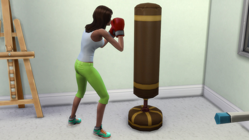 Claire punches a punching bag