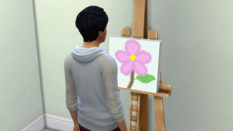Julian stands in front of his painting of a flower, that looks like a child made it