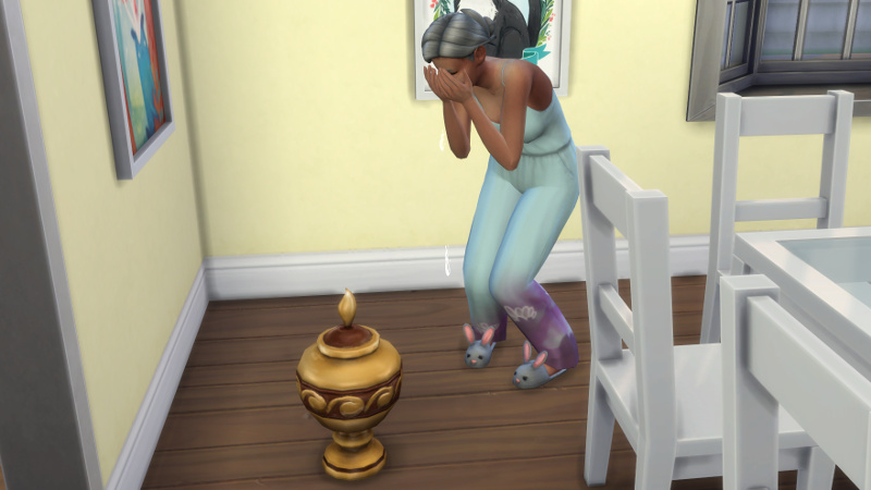 Stacey sobs over the urn