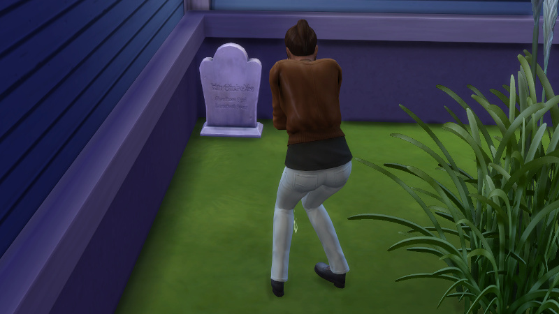 Rachel sobs in front of a gravestone at the front of the Coopers' house