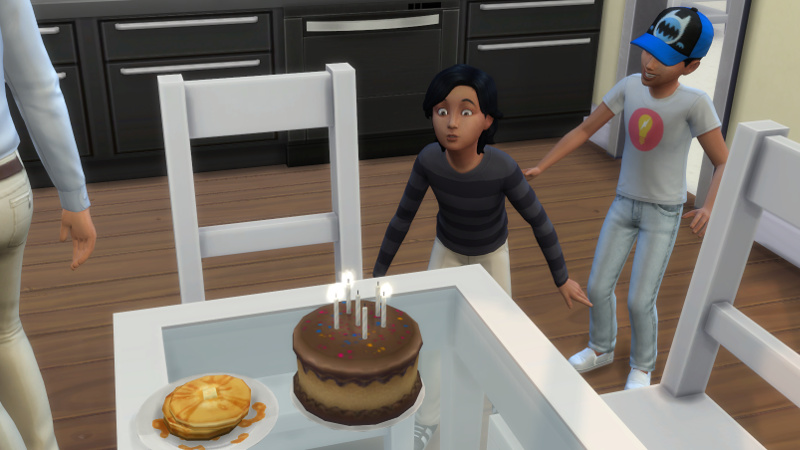 Troy blows out the candles on his birthday cake