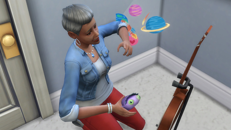 Stacey plays with kids' toys