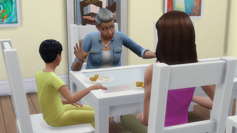 Stacey talks animatedly to Stacey and Abed at the breakfast table