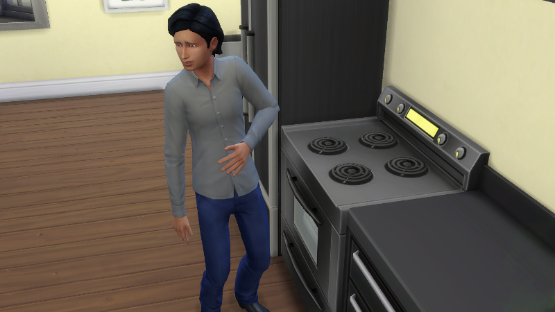 Troy stands next to the stove, complaining about being hungry