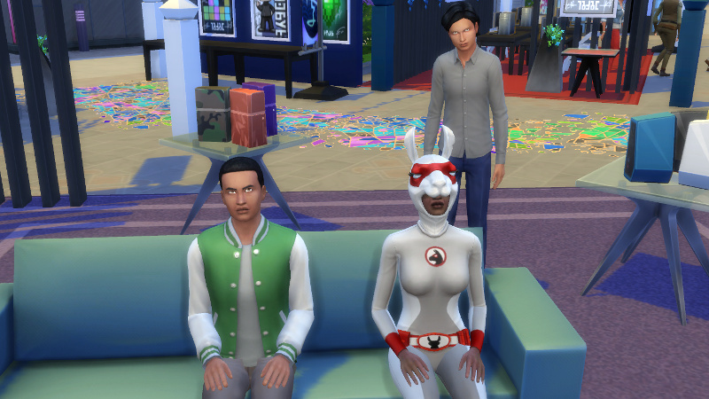 Troy, Amir and a costumed Christina watch a movie at GeekCon