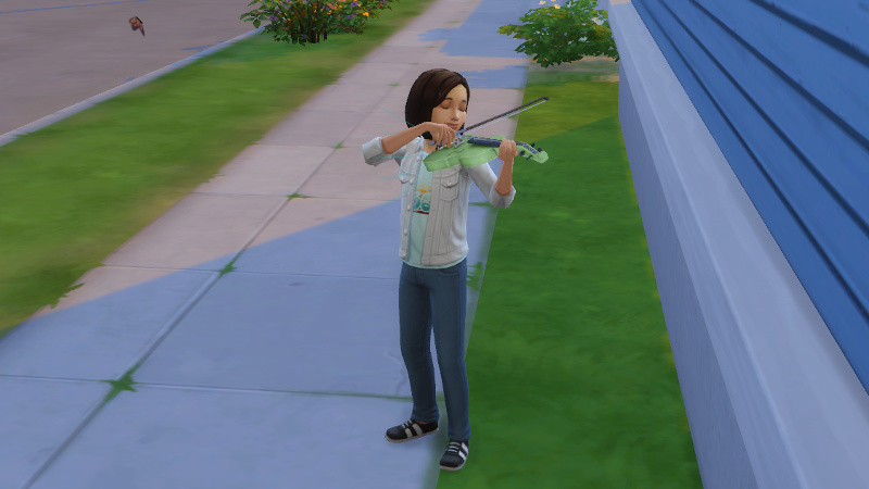 Britta plays her violin on the footpath by the side of the house