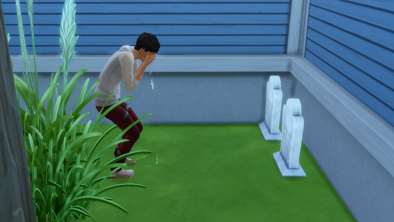 Julian cries at one of the gravestones