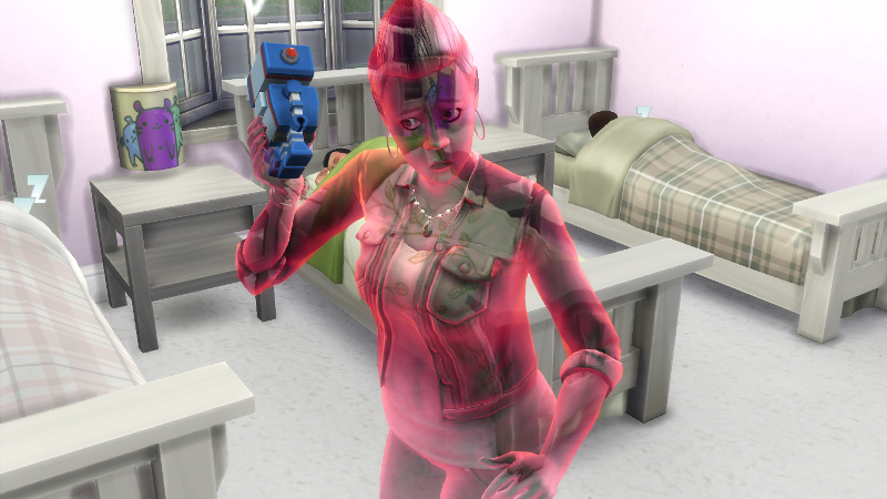 Stacey (still red) plays with a robot toy