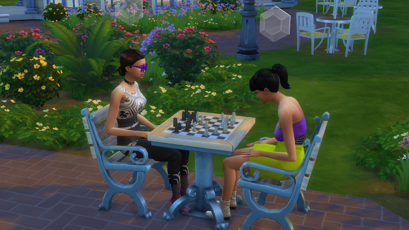 Britta and Kelsi Duff play chess