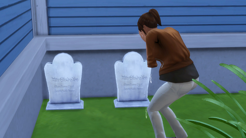 Rachel cries at her parents' graves