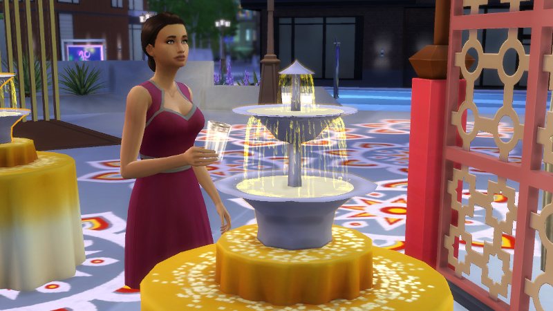 Britta takes a cup of light tea at a festival in San Myshuno