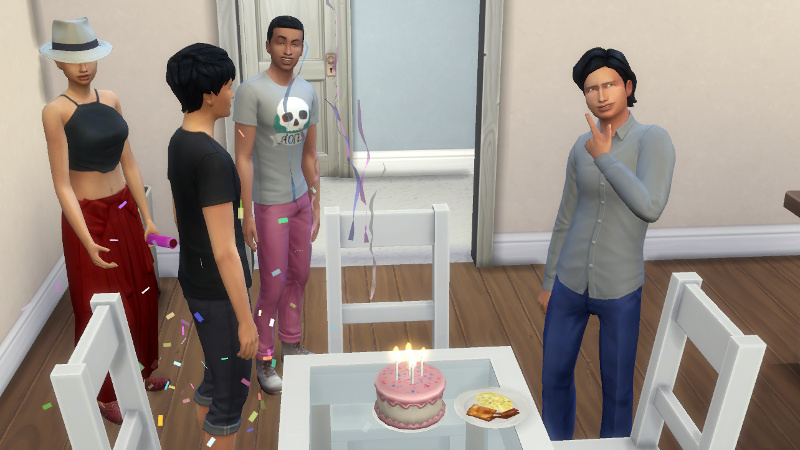 Troy makes a wish at his birthday cake