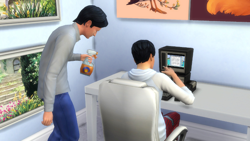 Troy sprays some cleaning fluid into the side of Julian's face as Julian sits and types at his computer