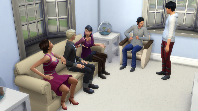 Britta talks to Ulrike and Wolfgang on the couch; Troy and Julian chat in the background