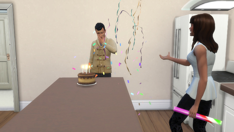 Abed strokes his chin as he examines the cake and Claire gestures at him, as confetti continues to fall